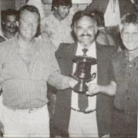 Bill Thomas, with Coach John O'Connell (far right) accepts the 1985 Night Series Trophy